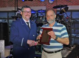 MSFA President Mike Davis presenting an award to host company Junior #2 President Charles Abrecht.