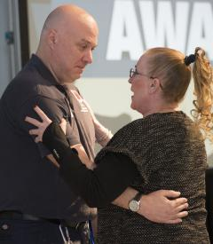 Moments after being announced as the telecommunicator of the year award recipient, 911 call taker William Andrews was joined by Karen Osborne, who credits Andrews with saving her life. Mr. Andrews volunteers with the Graceham Volunteer Fire  Company.  Photo credit by Graham Cullen
