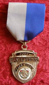 The Silver Spring Trophy was established in 1981 by the Silver Spring Volunteer Fire Department.  The award is presented each year at the MSFA Annual Convention to an individual who does the most in fire prevention for his/her community.
