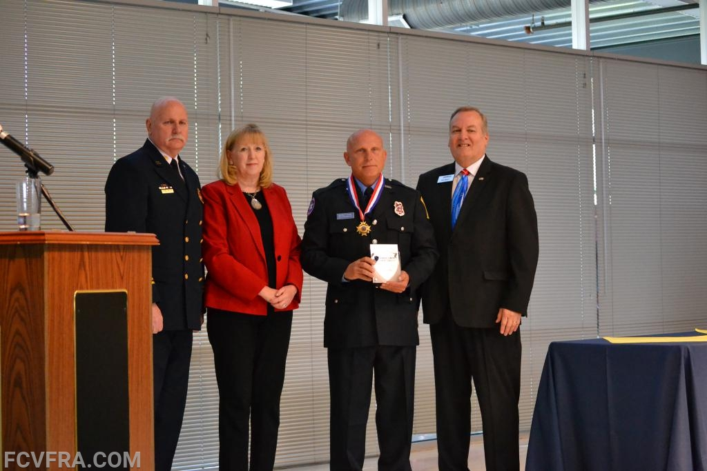 Pictured left to right are Chief Tom Owens, County Executive Jan Gardner, Jeffrey Scire and Volunteer  Services Director Kevin Fox.   Photo courtesy of N. Burriss.