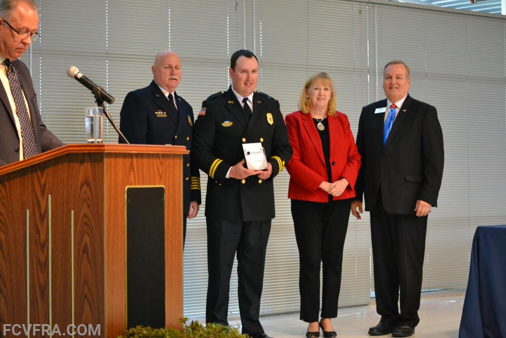 Pictured left to right are Chief Tom Owens, Alex McKenna, County  Executive Jan Gardner and MC Rick Weldon.  Photo courtesy of N. Burriss.