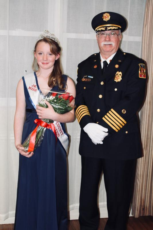 Graceham President Gary Keller and Junior Miss Fire Prevention Elizabeth Schuebel share a moment at the ceremony.