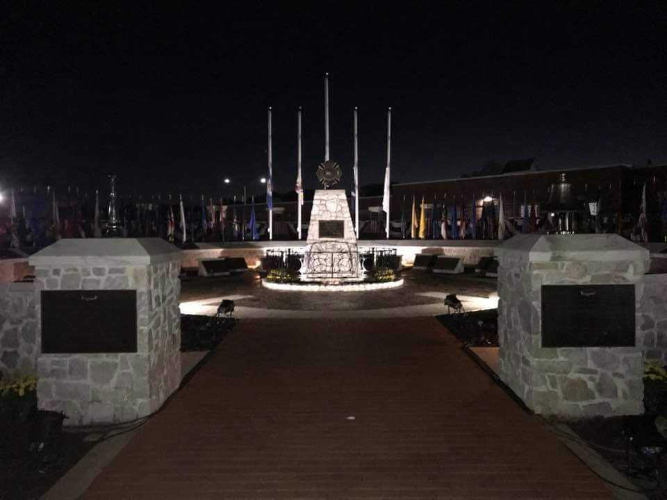 This was the scene pre-dawn Saturday at the National Fallen Firefighters Monument. (Photo by Greg Collier)