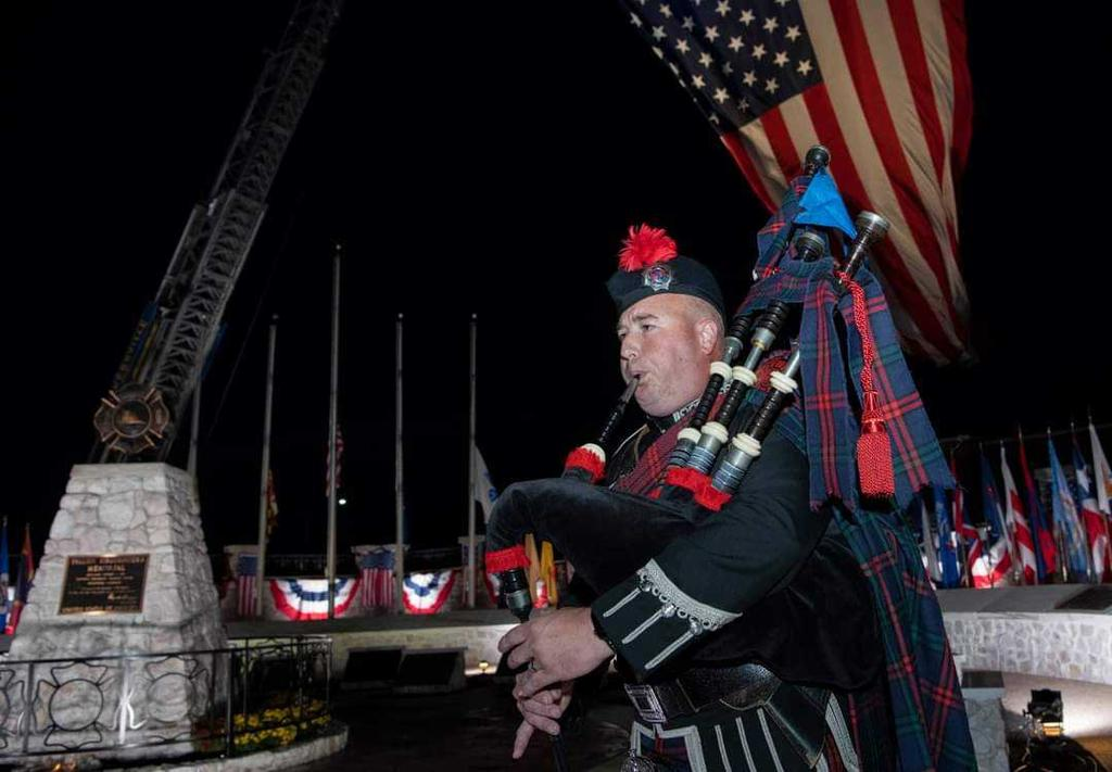 A piper plays during the National Fallen Firefighter Candlelight vigil Saturday night. (Photo by Bill Green)