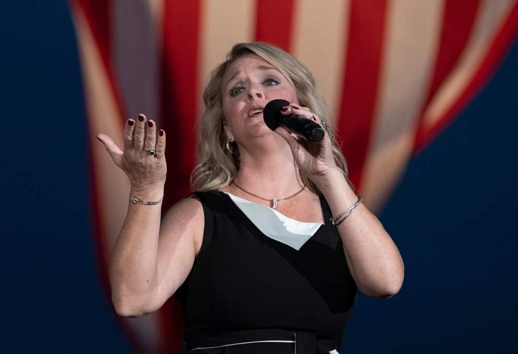 Teresa Jacobs sang during the National Fallen Firefighters' Candlelight Vigil Saturday night. (Photo by Bill Green)