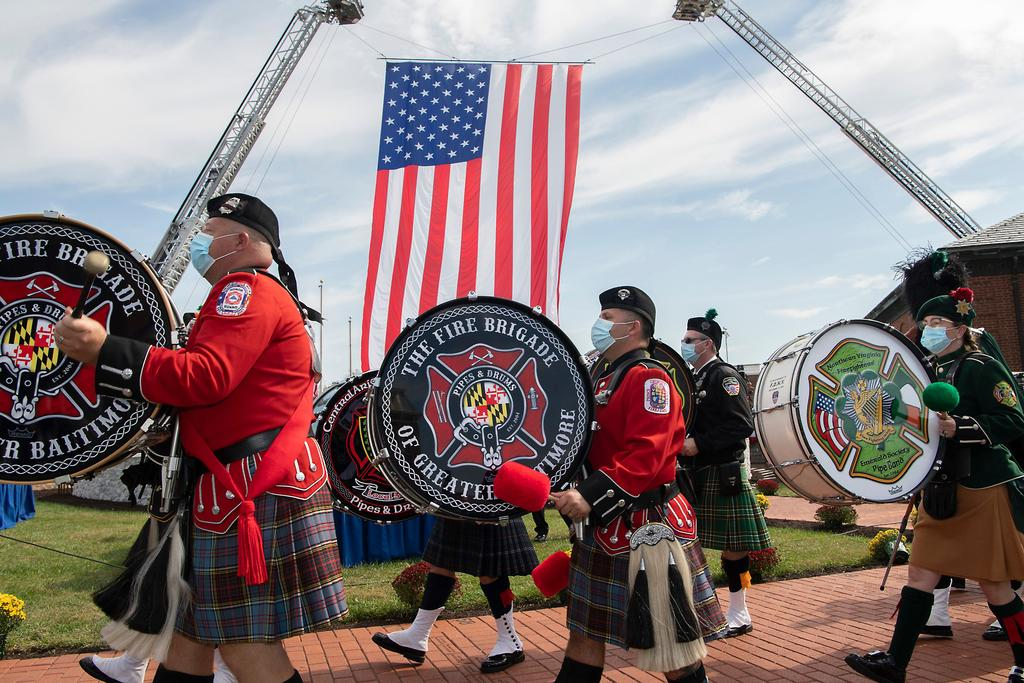 The pipe and drum band plays tribute to fallen heroes. (Photo by Claudia Garner)