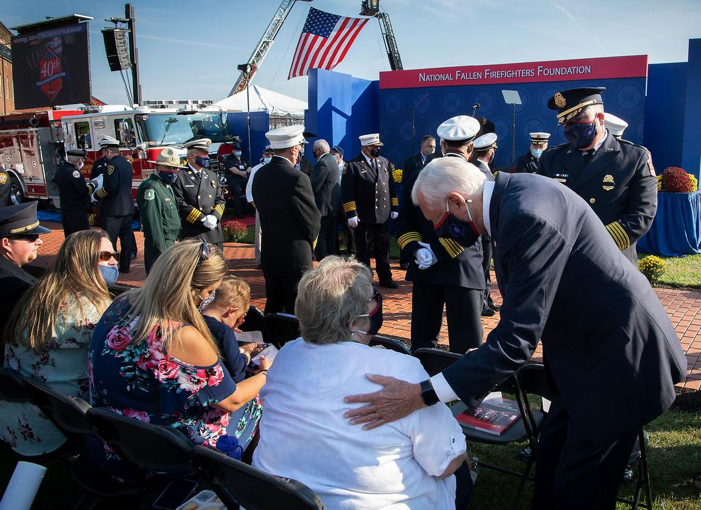 U.S. Congressman Steny Hoyer consoles Linda Powers at the National Fallen Firefighter Memorial Service. (NFFF photo)